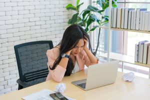 Woman working from home who's website is not working the way it should